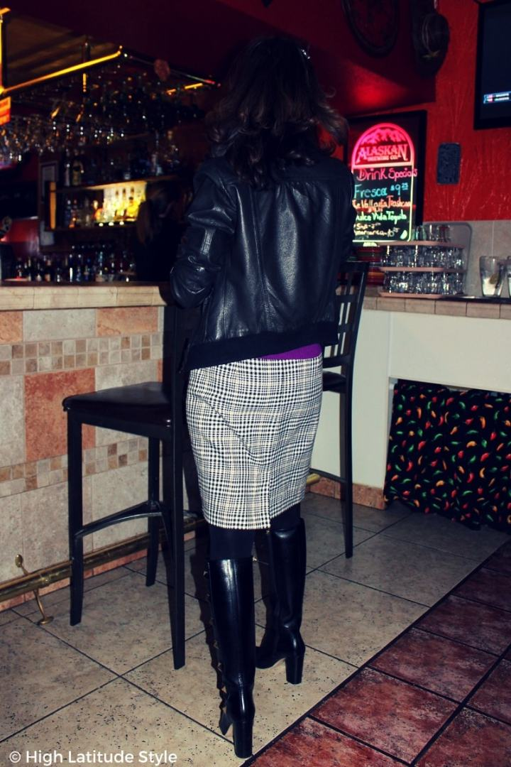 #advancedstyle mature woman in winter work look with leather bomber and houndstooth skirt