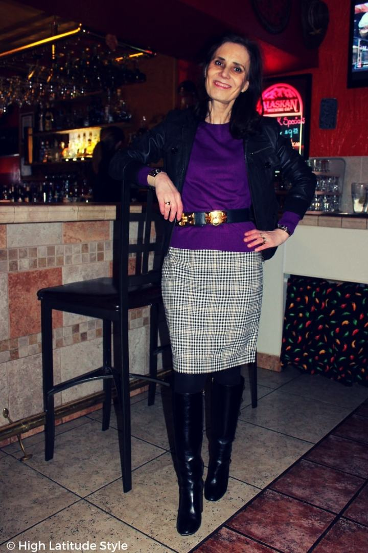 #fashionover50 style blogger Nicole in winter work outfit with bomber, houndstooth and studded boots