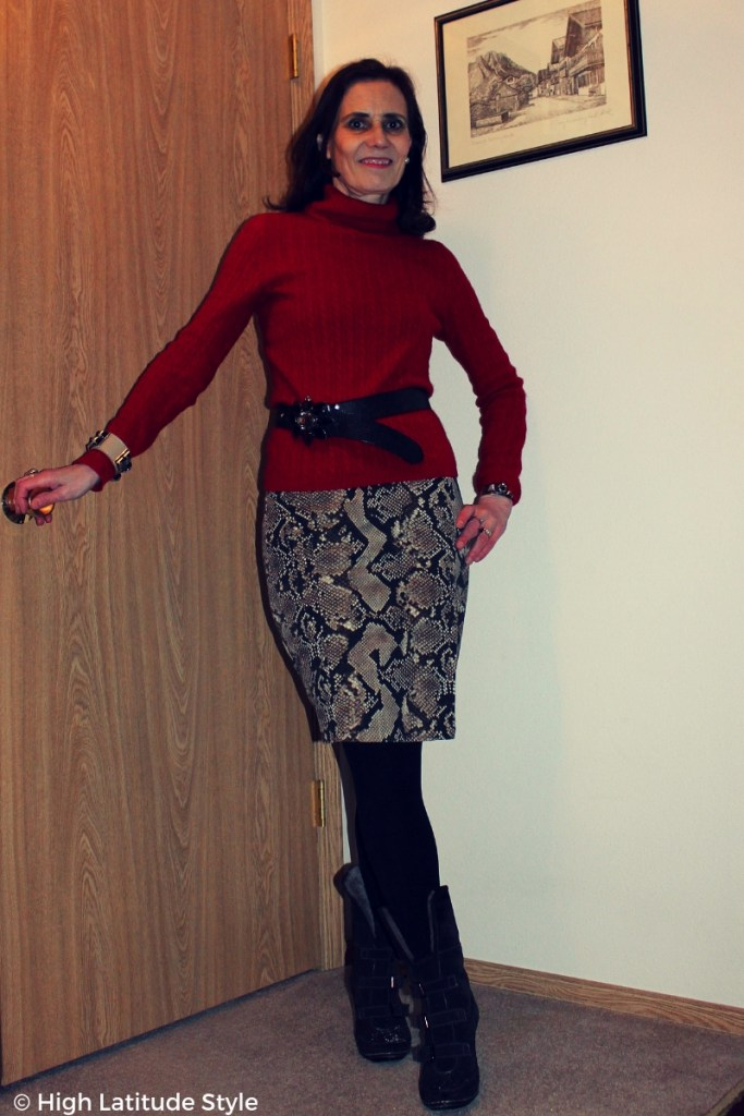 mature woman in business casual office looks with snake design skirt, sweater, tights and boots