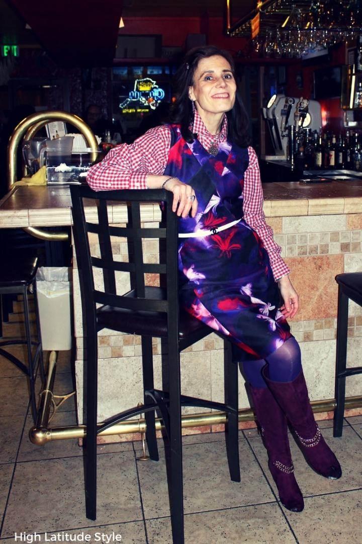 fashionista wearing a scuba abstract floral print dress with gingham shirt mixed pattern trend