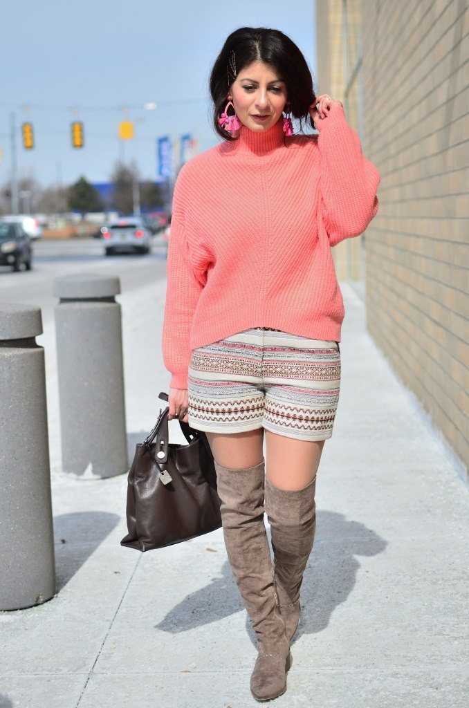 Top of the World Style Winner Rama in pink sweater, otk boots and striped shorts