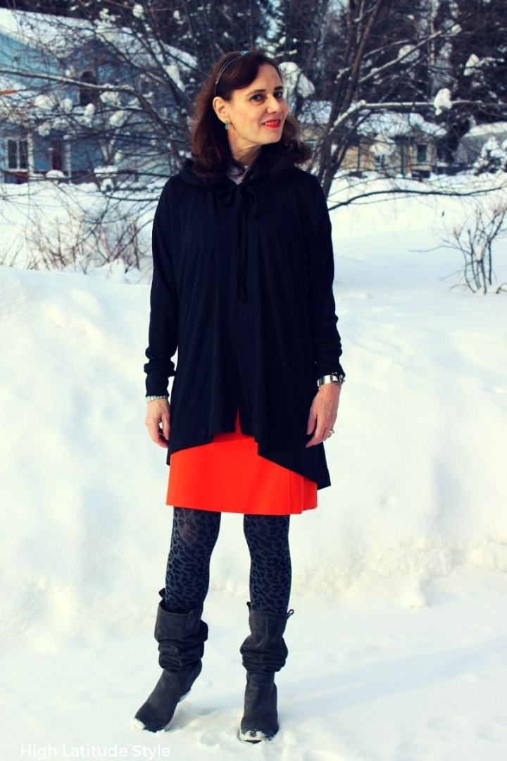 #fashionover50 midlife women in long cardigan over skirt with tights and slouchy boots