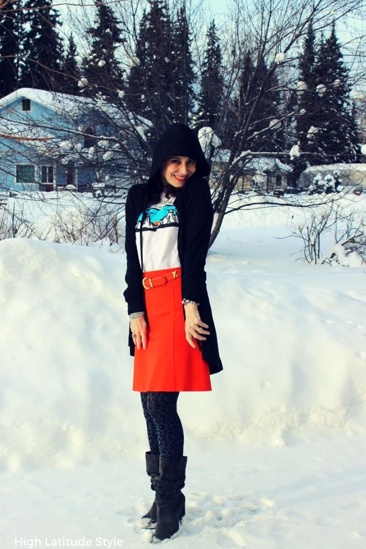 #grassrootdesigner style blogger in Tricia Tanaka cape.hoodie with orange skirt, T-shirt, loe tights and slouchy boots