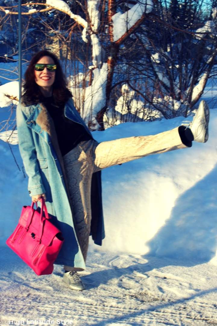 #fashionover50 Nicole of High Latitude Style making fun in a jean coat and snake print pants