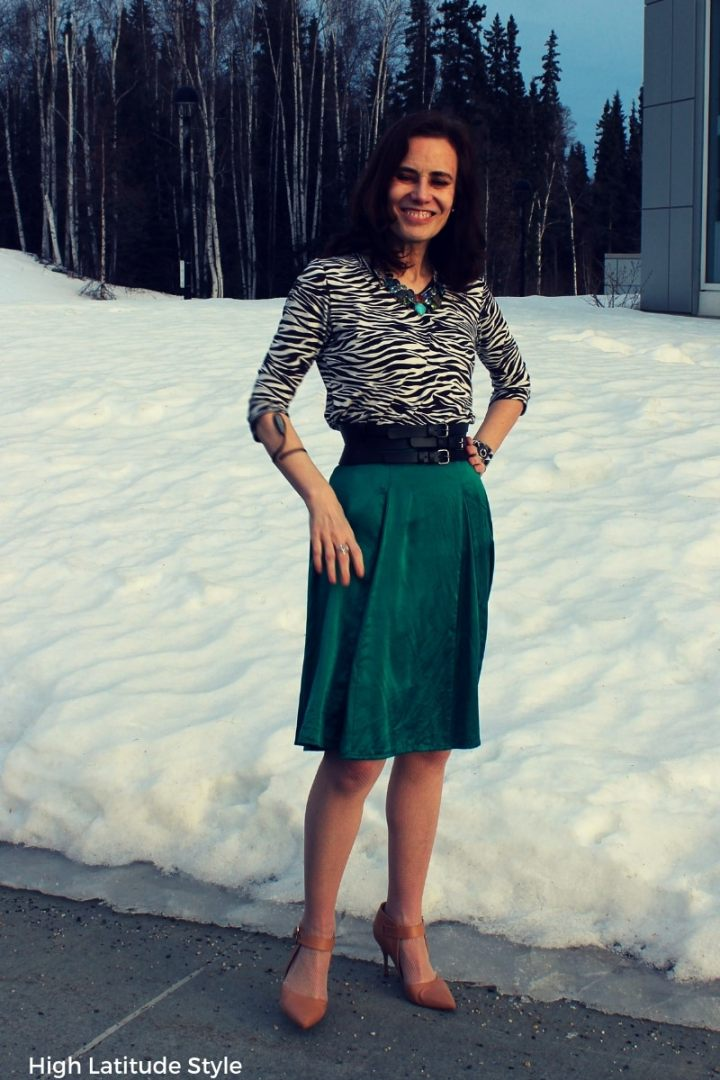 blogger Nicole in Pantome color skirt with zebra top in front of melting snow