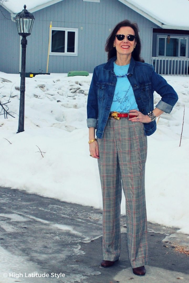 blogger in casual business outfit with wool trousers, shirt, jacket and statement belt