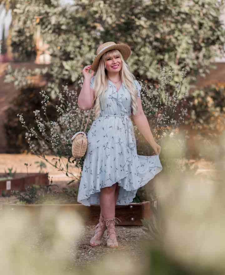 Elizabeth Hugen aka Lizzie in Lace showing her legs in a feminine ruffle dress