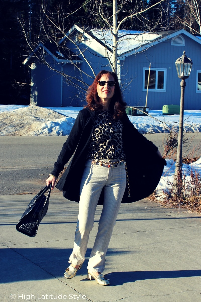 Nicole wearing street chic with statement belt, sunnies, trouser, cape, cardigan and statement shoes