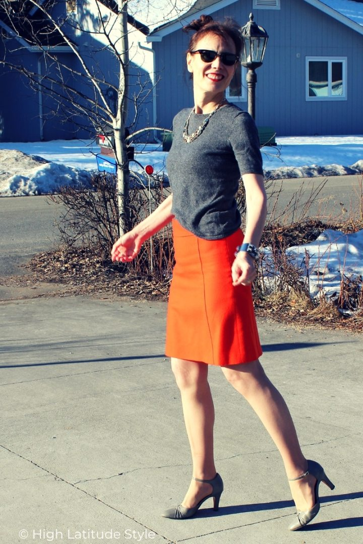 blogger Nicole in orange skirt, gray footwear and sweater