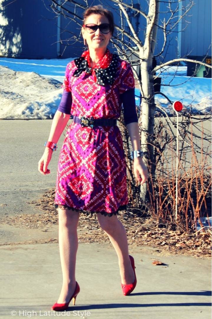 blogger wearing block print inspired dress with polka dot scarf