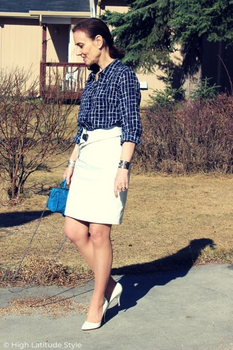mature woman in blue and white summer work outfit
