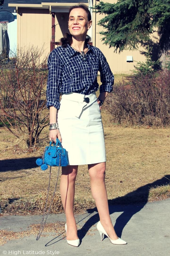 over 50 years old lady in classic summer look with leather skirt
