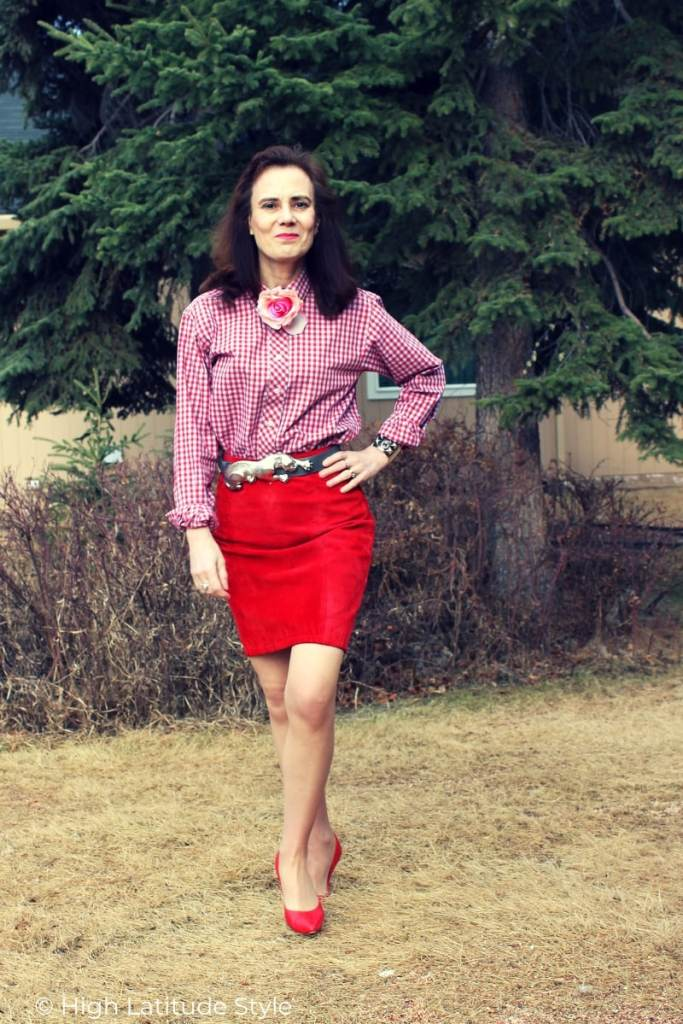 blogger in dressy business casual with suede skirt and gingham top