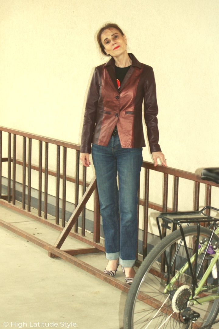front view of casual outfit with BF jeans and ruby and metalic maroon leather blazer c/o The Jacket Maker