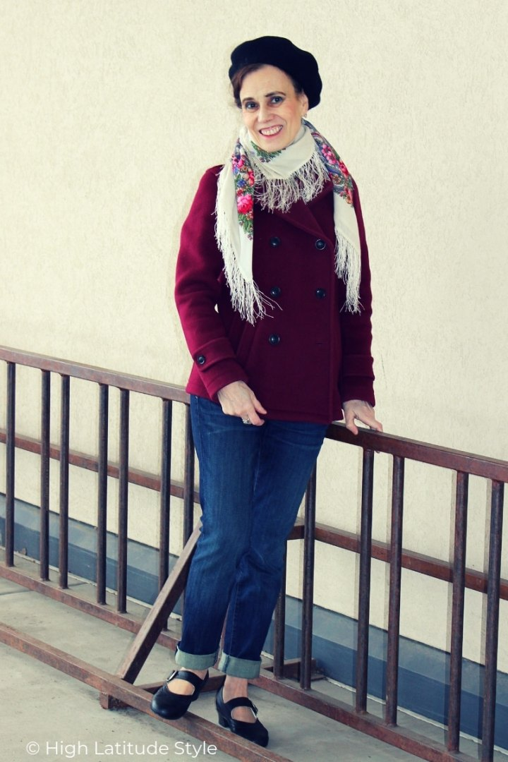 mature woman in investment burgundy peacot with beret and Russian floral fringe wool scarf