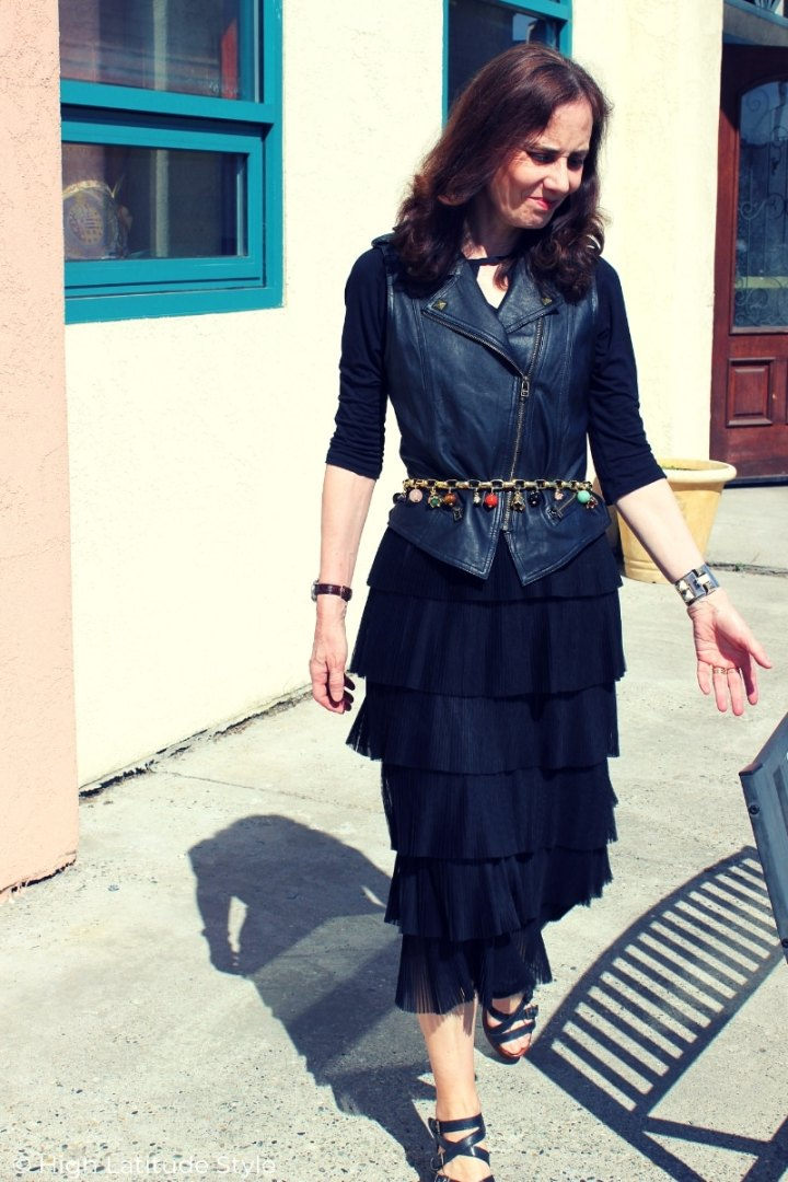 Alaskan blogger Nicole in black summer going out look with leather vest and keywhole top plus midi pleated tiered skirt