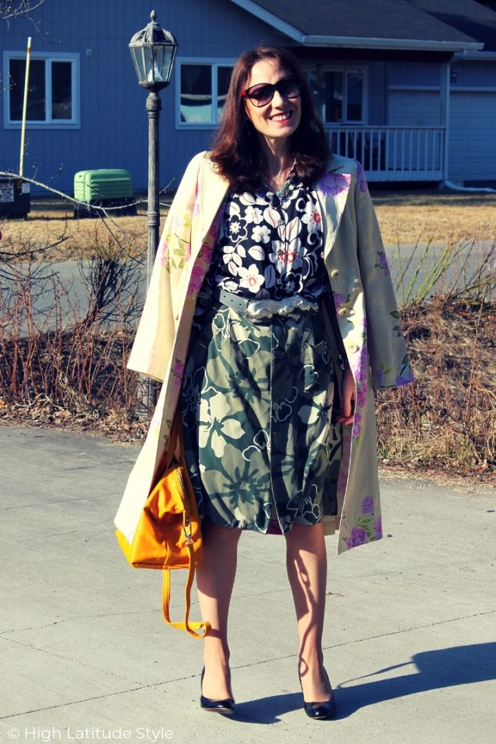 midlife woman doning this seasons mixed print trend of multiple florals