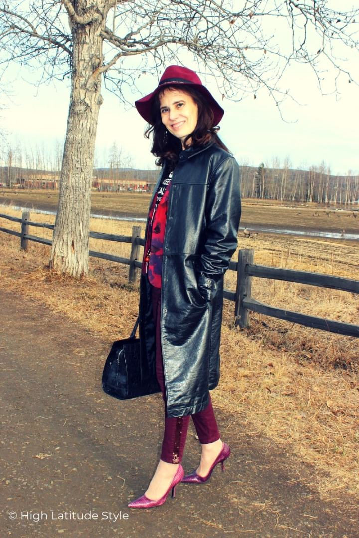 mature woman in leathercoat with fedora and high heels in spring