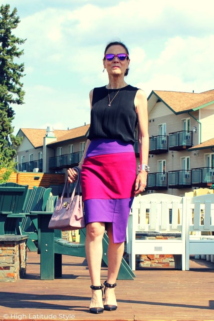 midlife woman in posh business casual skirt-shirt outfit