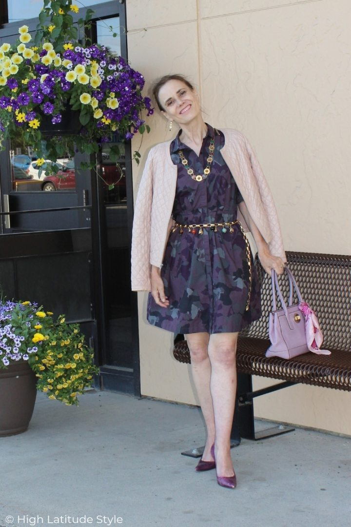 style book author in camouflage dress, snake printneckerchief, quilted jacket blush pink purple work look