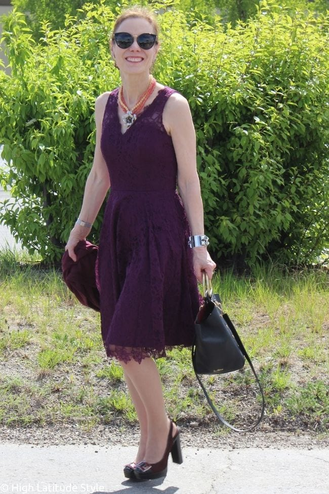 over 50 years old influencer in burgundy v-neck midi lace dress