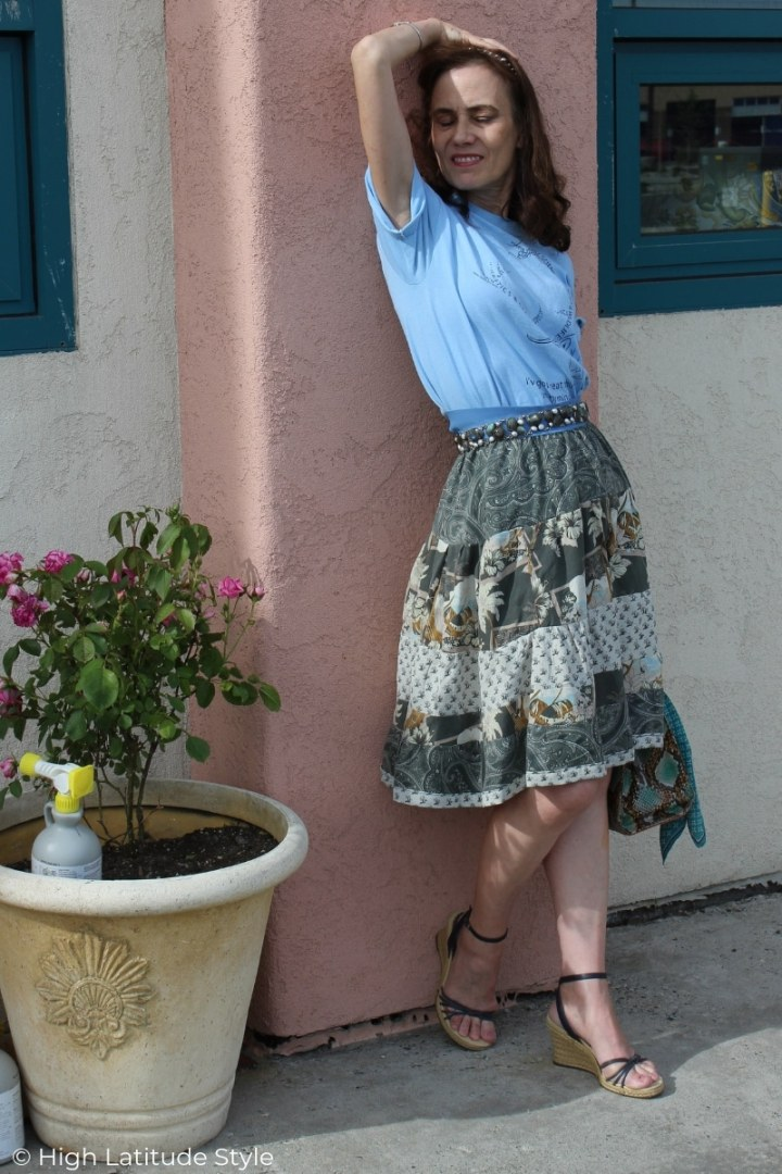 fashion blogger Nicole in graphic T, tiered skirt, statment belt and espadrilles