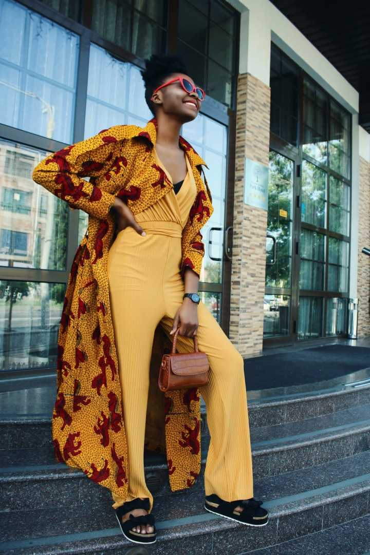 Top of the World Style Winner Méldoy Jacob in an Ankara coat and jumpsuit