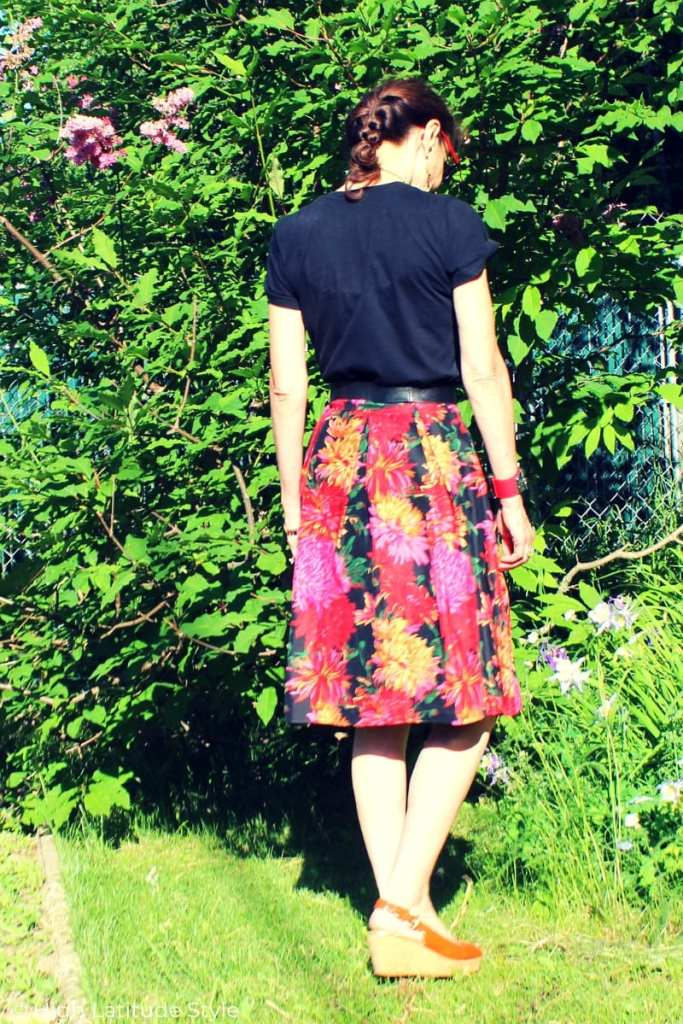 backview midlife fashion blogger in Tee and silk skirt