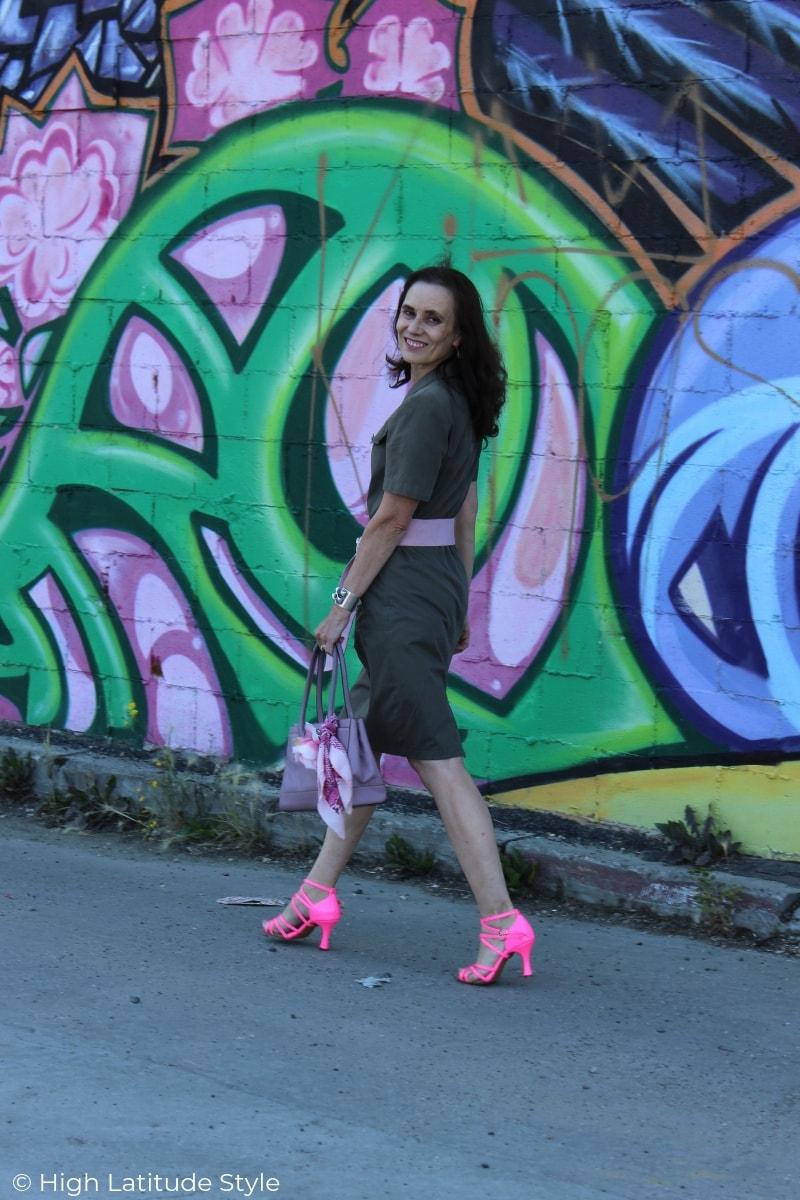 Style book author Nicole in olive dress with pink sandals