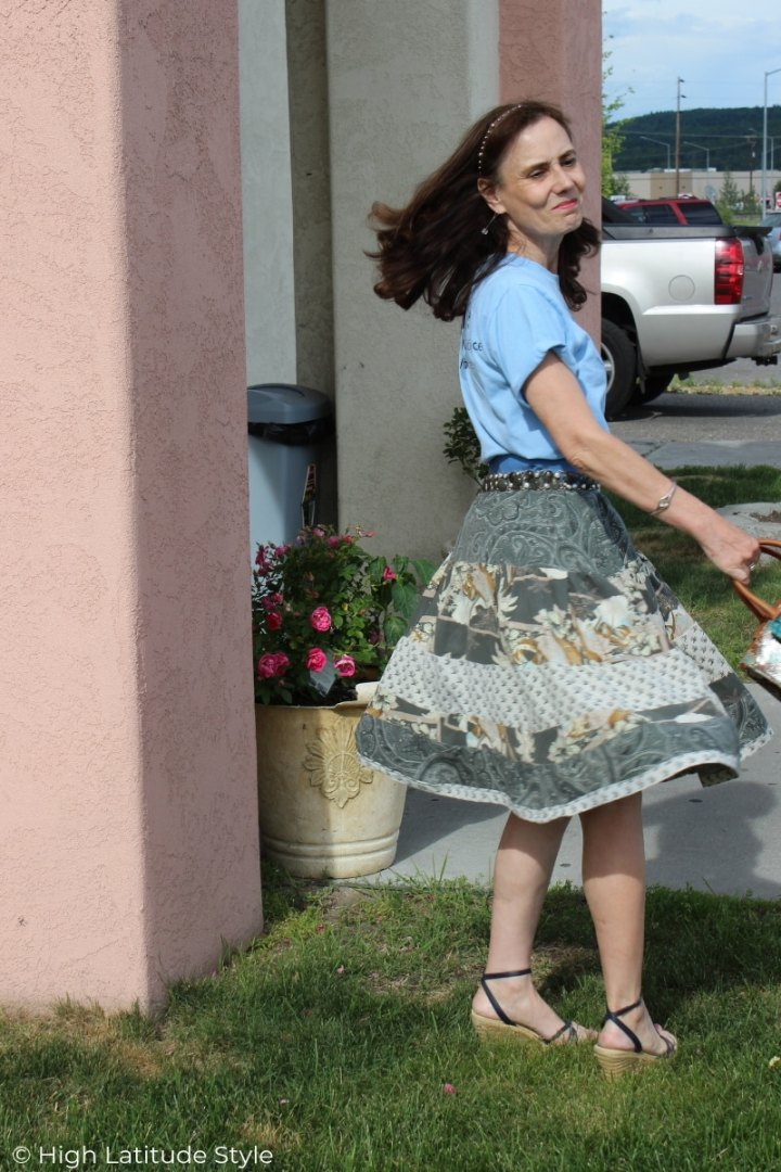 Nicole of High Latitude Style showing the movement of the DIY skirt