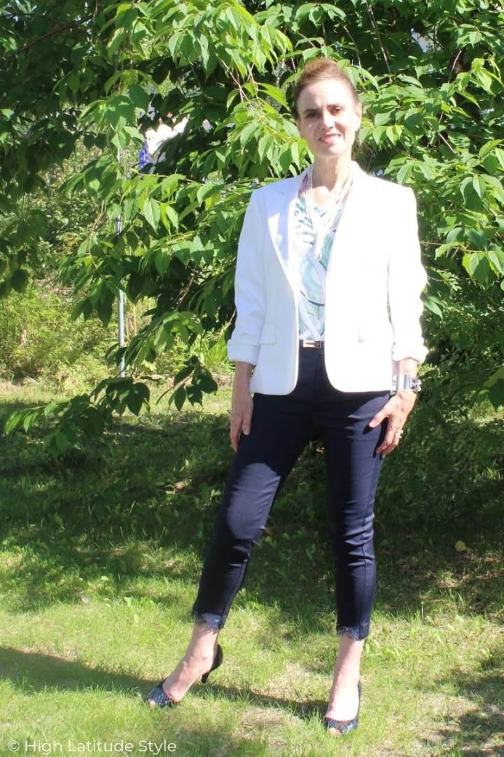 midlife woman in summer work look of pants, printed top, blazer and open-toe pumps