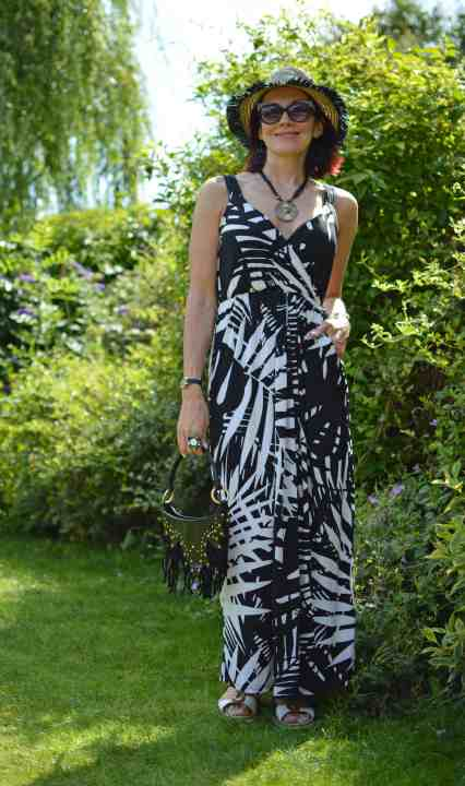 Emma of The Style Splash in zebra shoulder strap dress