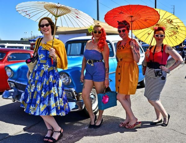 Ladies in retro clothes with parasols