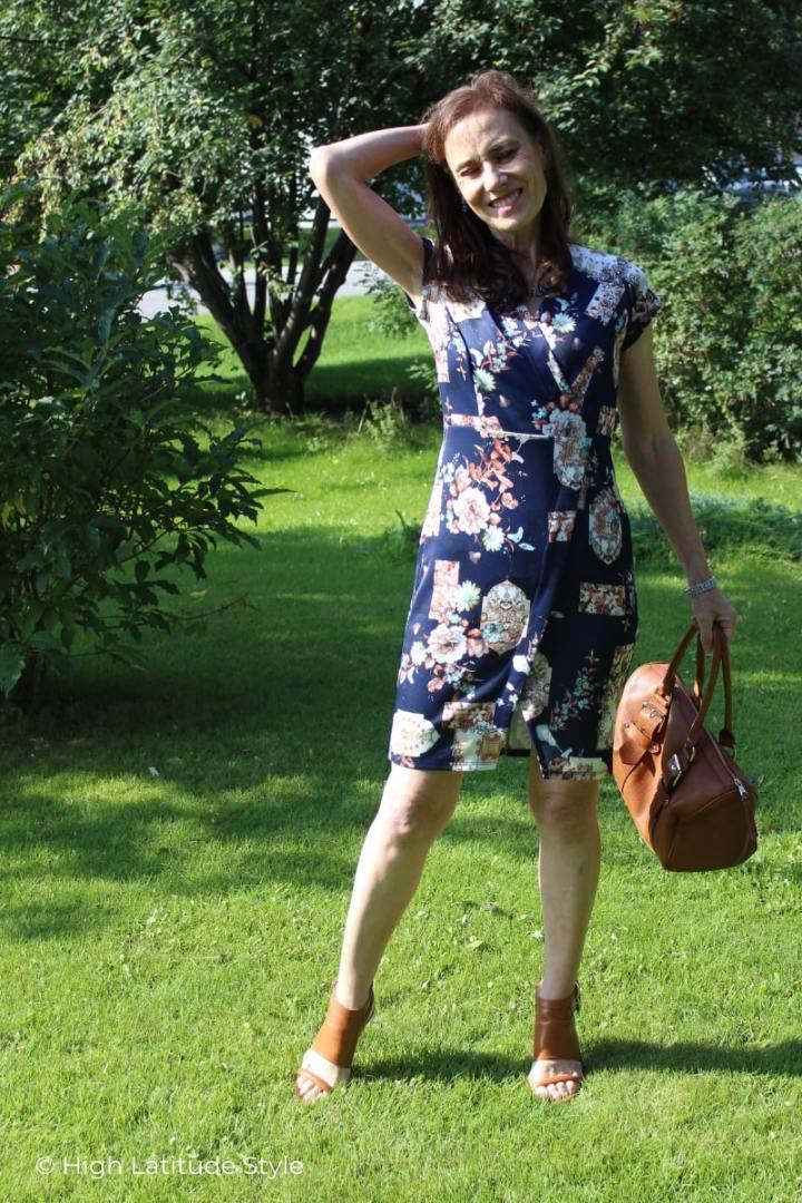 midlife woman in asymmetric cut sheath posing on a lawn