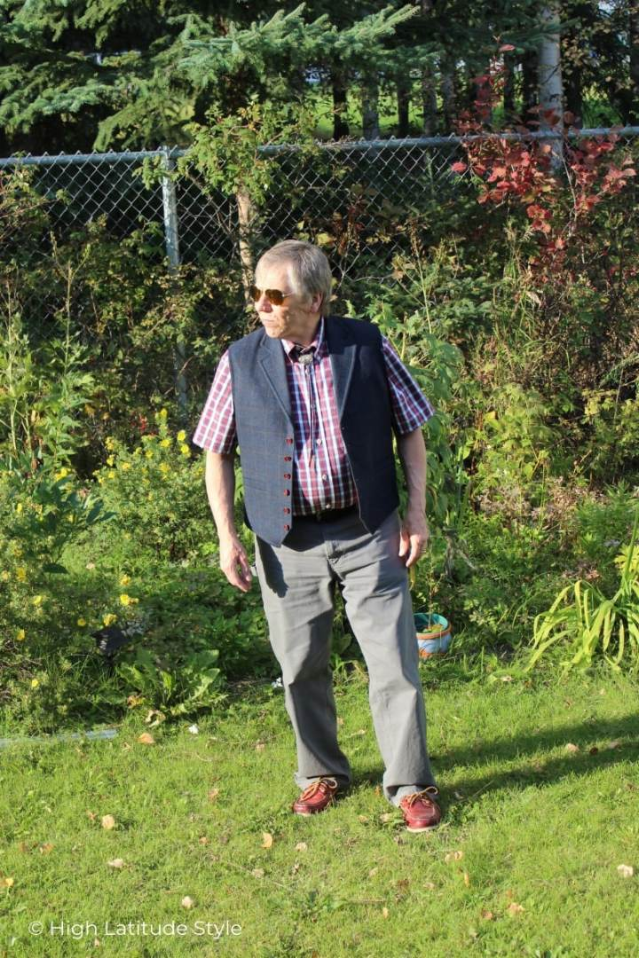 guy with plaid shirt and vest, slacks, boat shoes and aviator sunglasses