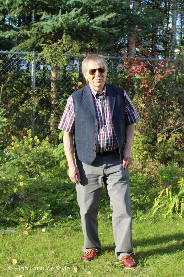 mature man in mixed prints, gray pants, red boat shoes and Eagle Eyes aviator sunglasses