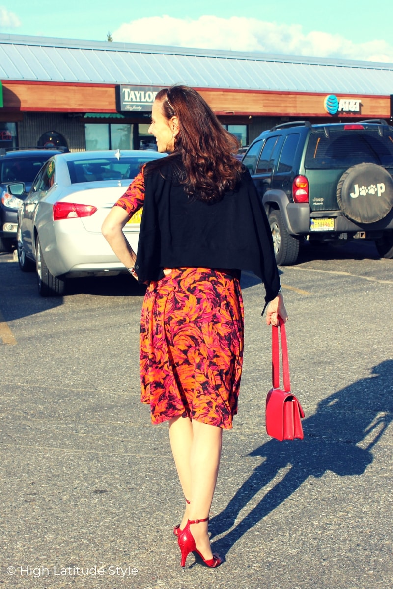 mature woman walking in a parking lot in fall business casual fall dress and jacket with pumps