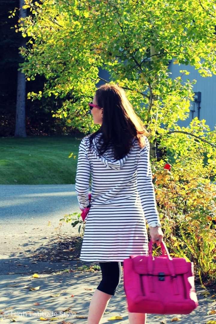 Alaskan blogger walking down the street in striped hoodie with cropped leggings