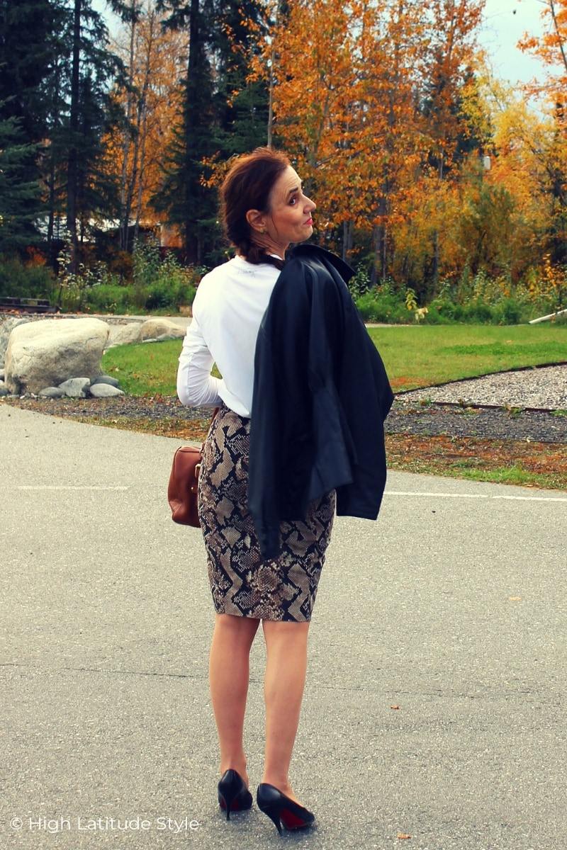 style blogger in all neutral color work outfit with animal print skirt