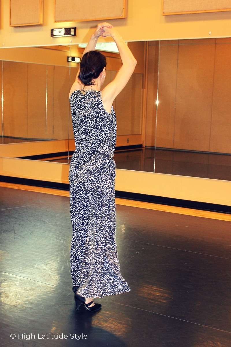 dancer in animal print ensemble of wide trousers with tailed tank