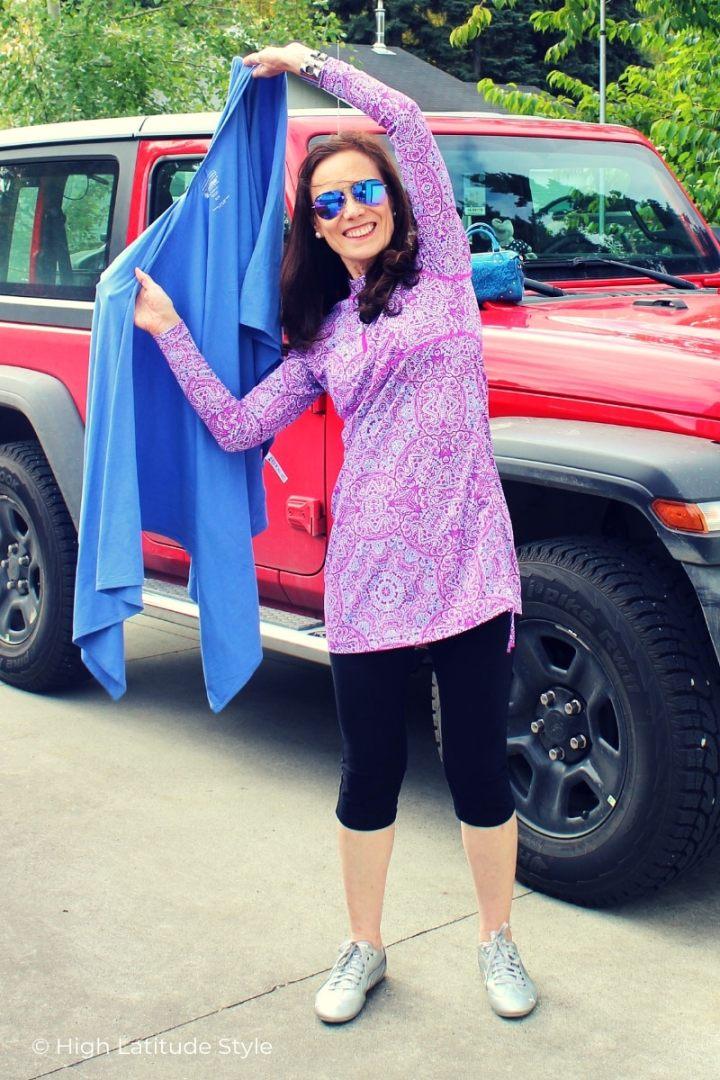 style blogger warpping a beach shawl around her swimwear