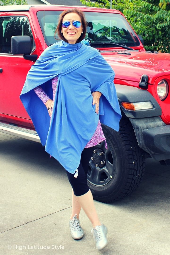 mature woman with leggings, top, sneakers, sunglasses and beachshawl