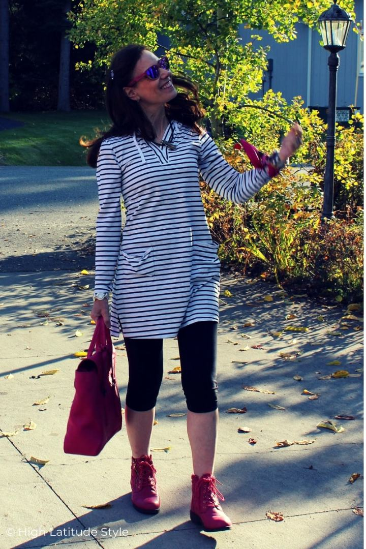 fashion blogger in striped bw top with leggings and pink accessories