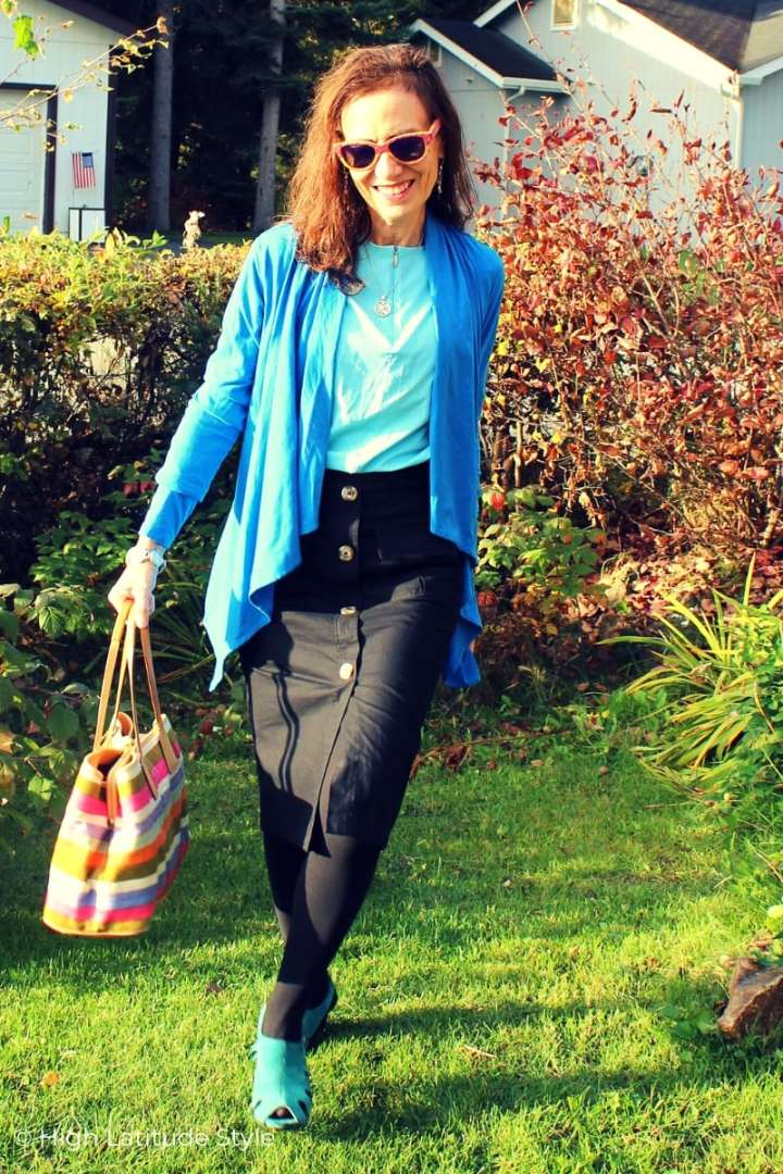 Nicole in Pantome inspired colors waterfall cardigan, shirt, skirt, tight and turquoise sandals with striped bag