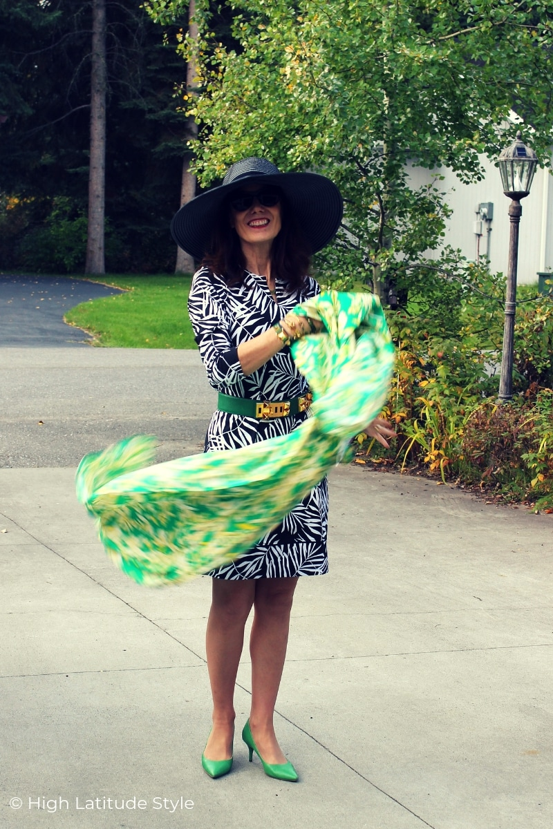 over 50 years old blogger in print dress with scarf living life to the fullest