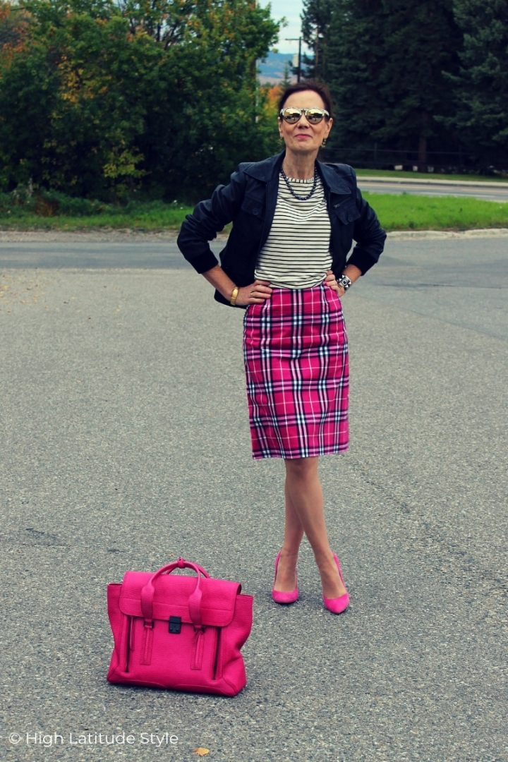 street style blogger Nicole in aviator jacket, pink skirt, heels, black and white top