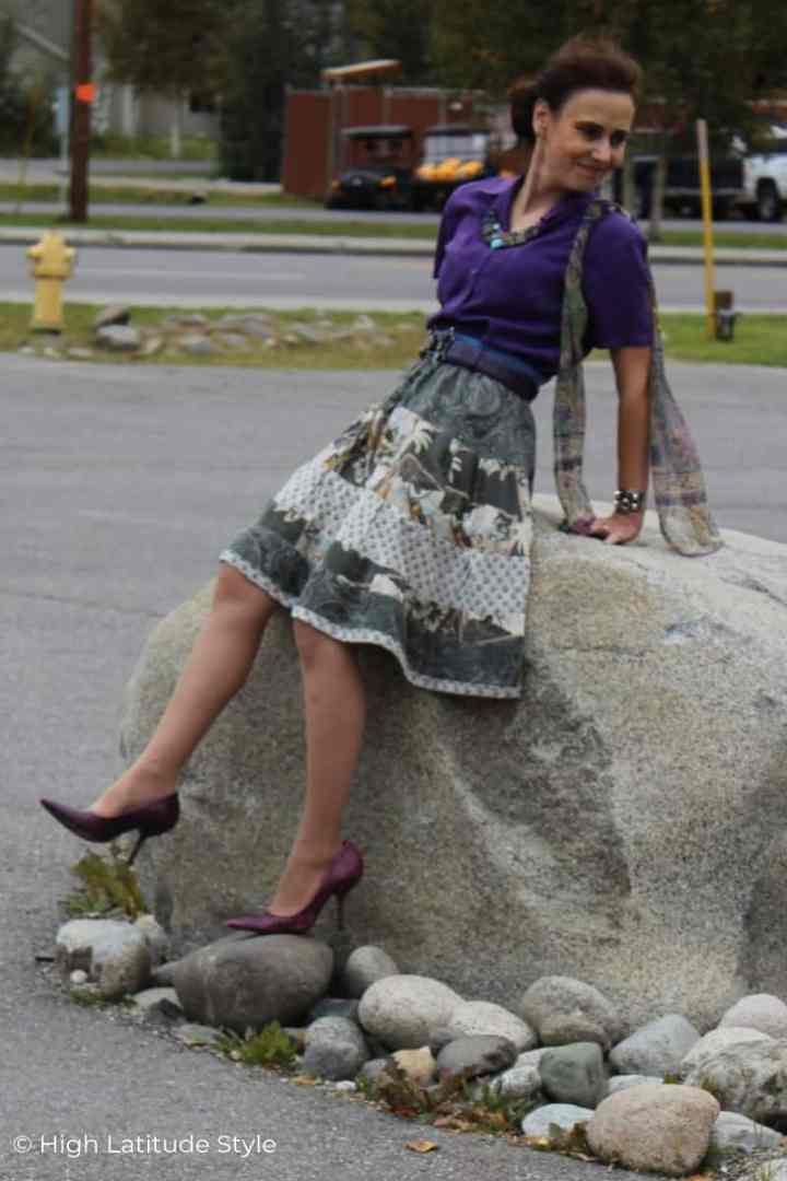 style blogger in purple shoes balancing on a huge rock