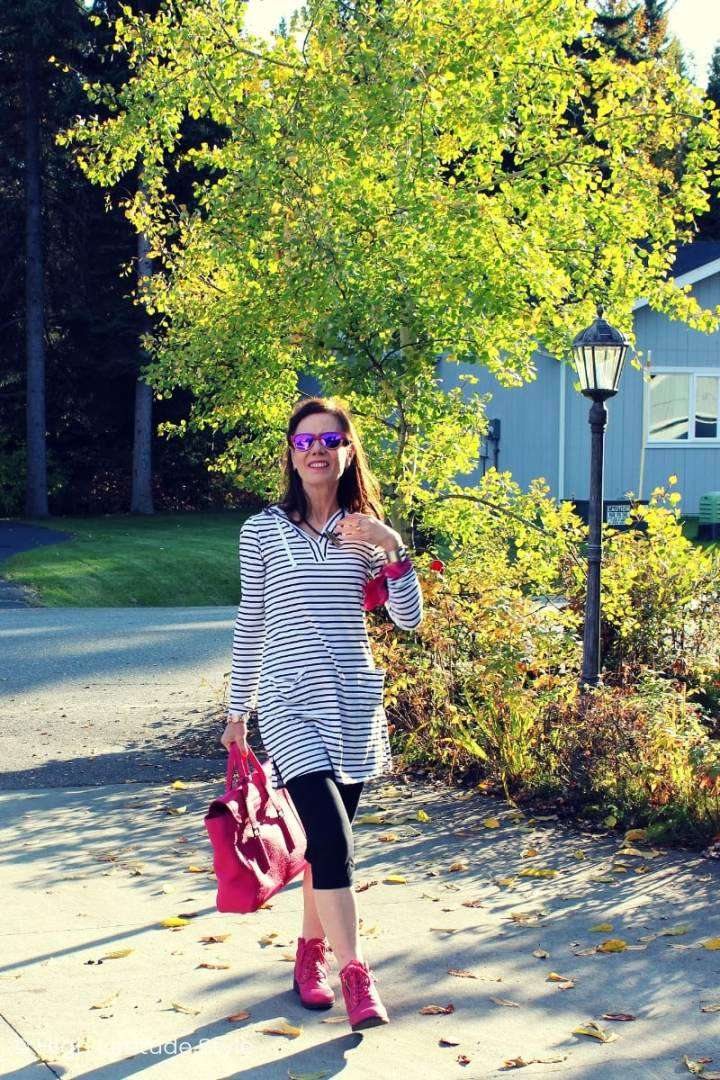 Alaskan fashion blogger in black and white weekend look of bikers and striped hoodie dress