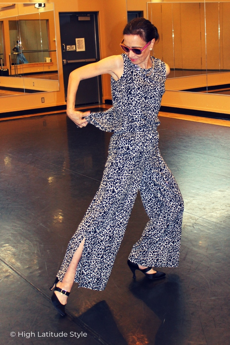 dancer striking a pose to show off slit and tail of the outfit