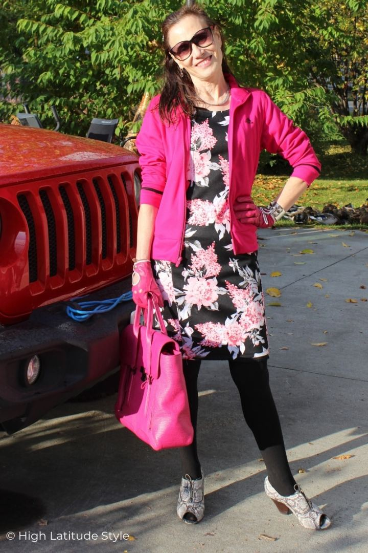 Nicole of High Latitude Style in flower print dress, pink jacket and gloves, black tights and fall booties